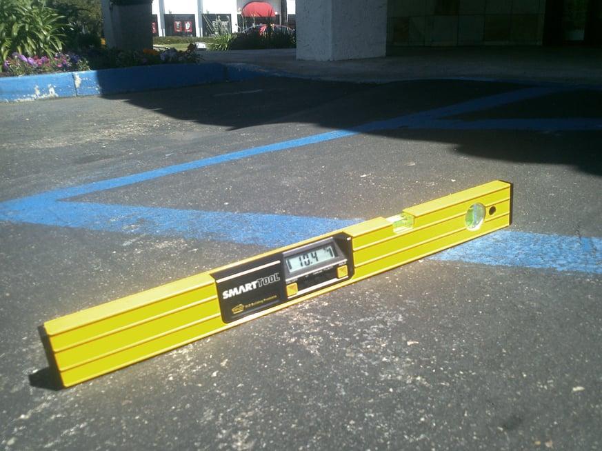 Grade violation on access aisles  .jpg