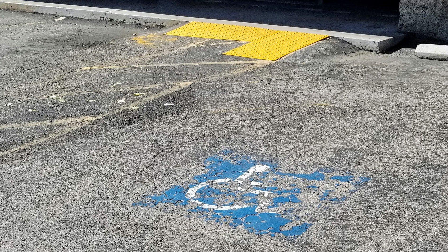 bad ramp for ADA handicap stall