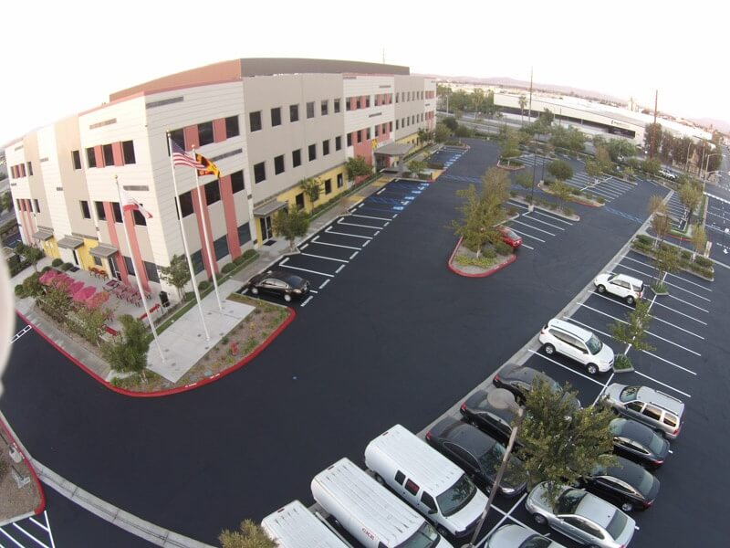 Maintain asphalt parking lot with seal coating