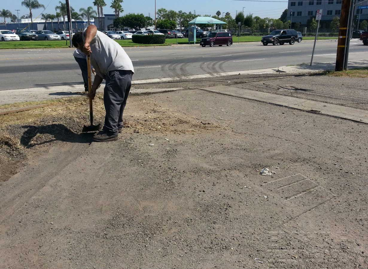 asphalt-repairs-anaheim-california-carls-jr-digging.jpg