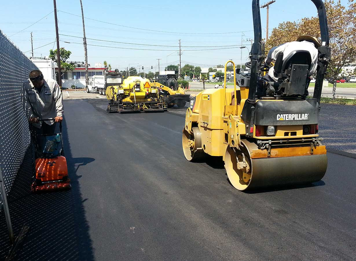 asphalt-repairs-anaheim-california-carls-jr-paving-machine.jpg