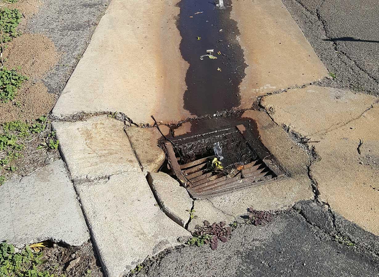 redlands-asphalt-repair-concrete-swell-before.jpg